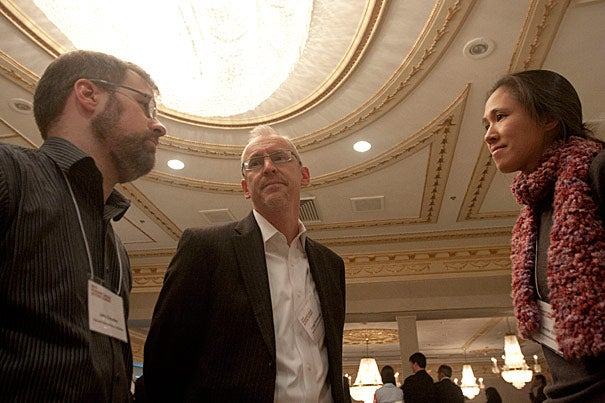"John Crowley (from left), Gregg Greenough, and Jennifer Chan authored the report ""Disaster Relief 2.0,"" released on March 28. The report looks at the new information flows, such as the Haiti OpenStreetMap, that result from recent technological advances."