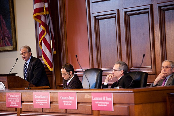 A year and a day after President Obama made the Patient Protection and Affordable Care Act official, three legal scholars took up the question of whether or not the it violates the U.S. Constitution.  Among them were moderator I. Glenn Cohen (left), Randy Barnett, Charles Fried, and Laurence H. Tribe.