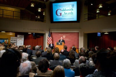 "Departing New York Times op-ed columnist Frank Rich (at podium) received the Goldsmith Career Award for Excellence in Journalism in a ceremony March 7 at Harvard Kennedy School. Shorenstein Center Director Alex Jones said of the award winner, ""His departure is akin to Tom Brady leaving the Patriots."""