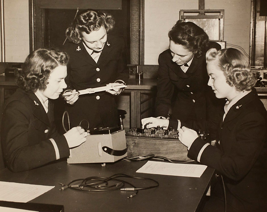 """Harvard University Archives image. Inscription reads, """"Navy, L to R, Ensigns E. Schwerin, Norma Meyer, Olga Quadland, and Edith Paulsen, Engineering 263-5 Course at Pierce Hall, October 23, 1943."""" Stephanie Mitchell/Harvard Staff Photographer"""