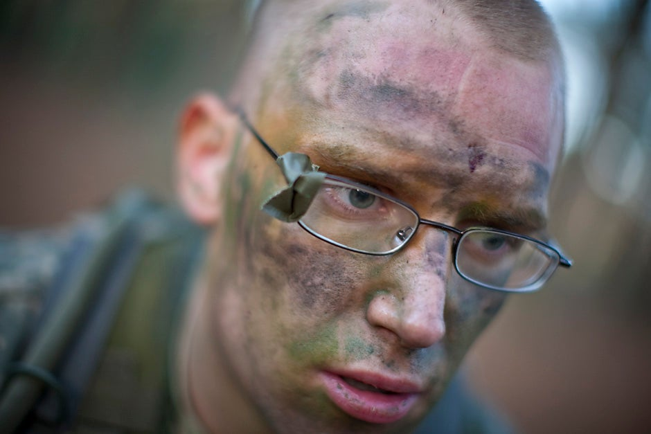 """Karl Kmiecik '10, his glasses repaired with OD Duck Tape, after a long day of training. Members of the Paul Revere Battalion Army ROTC program, including students from Harvard University, participated in the annual spring week end training exercise at Fort Devens in April 2008. Called """"FTX,"""" it is training exercise for students held twice a year. Justin Ide/Harvard Staff Photographer"""