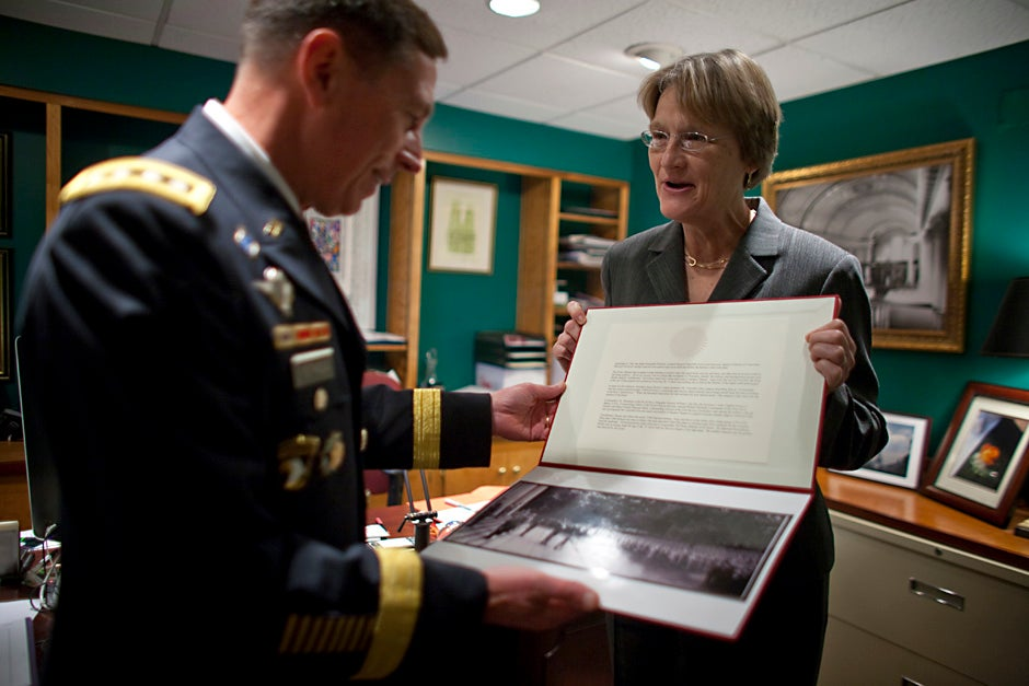 Harvard President Drew Faust presents Gen. David H. Petraeus with a historical photo of Winston Churchill speaking on the steps of Memorial Church to military officers after World War II. Petraeus spoke at the 2009 ROTC commissioning ceremony. Justin Ide/Harvard Staff Photographer