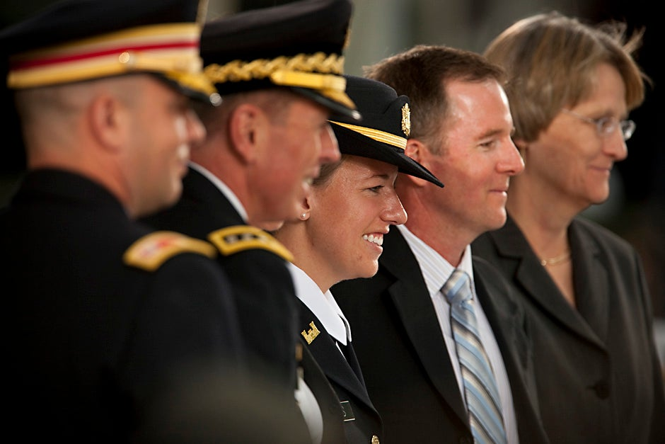 Second Lt. Roxanne Bras poses for a photo with her parents and dignitaries at the 2009 ROTC commissioning ceremony at Harvard. Justin Ide/Harvard Staff Photographer