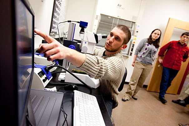 Postdoctoral student Julien Bachelier (left) with graduate student Becky Povilus and lab technician Kurt Schellenberg show off the state-of-the-art equipment at the Arnold Arboretum's new Weld Hill Research Building.