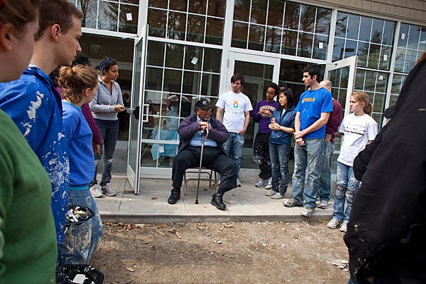 Bishop Bryant Robinson Jr. of the Macedonia Church of God in Springfield, Mass., speaks to the Harvard students who helped rebuild his church after it was torched on the night of Barack Obama's election. The students traveled to Springfield on the Phillips Brooks House Association's Alternative Spring Break, which promotes public service.