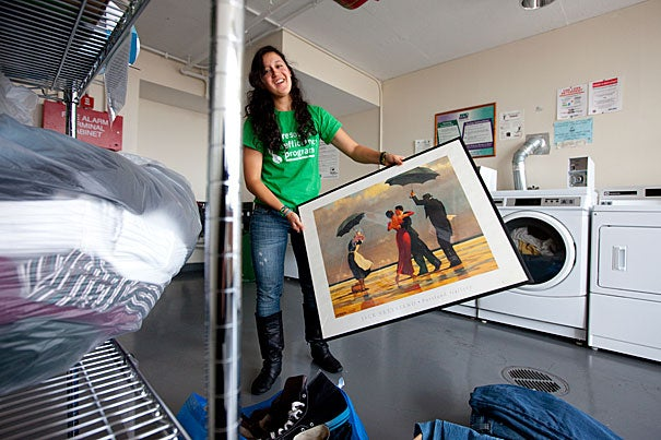 """Devon Newhouse '13, the """"Eco Rep"""" for Currier House, proves that trash can indeed be treasure: She hosts a swap for clothing — and whatever else — in the House's laundry room."""