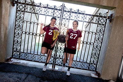 """I was prepared for the sacrifices that come with playing sports on a high level and getting my schoolwork done,"" said Mariah Pewarski (left), who, alongside teammate and fellow freshman Morgan Powell, plays both field hockey and lacrosse."