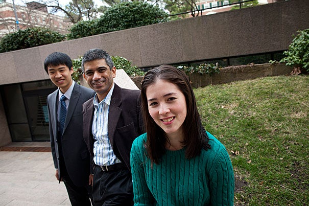 Annie Ryu (forefront) and Brandon Liu (far left) participated in a student project using text messaging to remind mothers in developing world countries about prenatal care. S.V. Subramanian (center) is their faculty adviser.