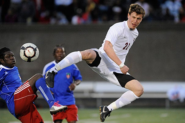 Harvard's Kevin Harrington '13 goes high to control the ball past a Haiti defender. The Harvard men's soccer team hosted the Haiti National Team in a fundraiser on April 10. The teams played to a scoreless tie, but Haiti won on penalty kicks in overtime, 4-1.