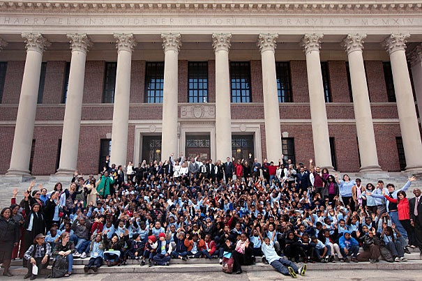The more than 300 kindergarten and fourth-grade African-American boys visiting Harvard for the launch of Impact 300 gathered for a group photo on the steps of Widener Library. For most of the boys, it was their first visit to a college campus.
