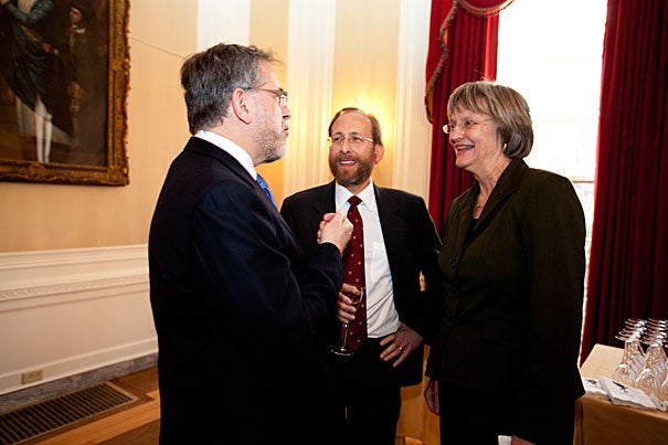 Outgoing Provost Steven E. Hyman (from left), incoming Provost Alan M. Garber, and President Drew Faust chat at a Loeb House reception held in Garber's honor. Garber's appointment is effective Sept. 1 .