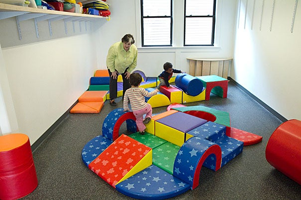 Co-Director Marcia Lieberman works with children in the redesigned play area of the Oxford Street Daycare Cooperative. Driven by the need to make significant engineering and plumbing upgrades, the Harvard-financed renovations were also an opportunity to bring both centers up to the standards of contemporary best practices for child care.