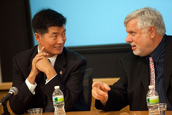 Lobsang Sangay (left) talks with Leonard van der Kuijp, professor of Tibetan and Himalayan studies, at a talk sponsored by the Fairbank Center for Chinese Studies.
