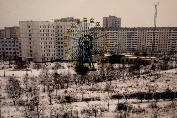 """Twenty-five years later, Chernobyl remains a deserted city in northern Ukraine. Nearby, 350,000 people were evacuated, including 50,000 from Prypiat, a workers' city a few kilometers away. To this day, it is a spooky ghost town, whose abandoned ferris wheel has become an iconic image of sudden disaster. """"The Day the Ferris Wheel Stood Still"""" by Tania D'Avignon is among the images on exhibit at the Knafel Building's Fischer Commons through Aug. 12."""