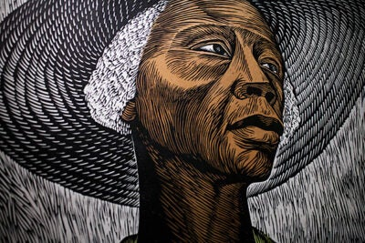 """DIGAME: Elizabeth Catlett's Forever Love"" features work by 96-year-old artist Elizabeth Catlett, including the color linocut ""Sharecropper"" (above, detail) from the 1950s. The exhibit is on view in the Du Bois Institute's Rudenstine Gallery through May 26."