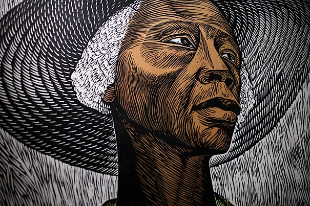 """""""DIGAME: Elizabeth Catlett's Forever Love"""" features work by 96-year-old artist Elizabeth Catlett, including the color linocut """"Sharecropper"""" (above, detail) from the 1950s. The exhibit is on view in the Du Bois Institute's Rudenstine Gallery through May 26."""