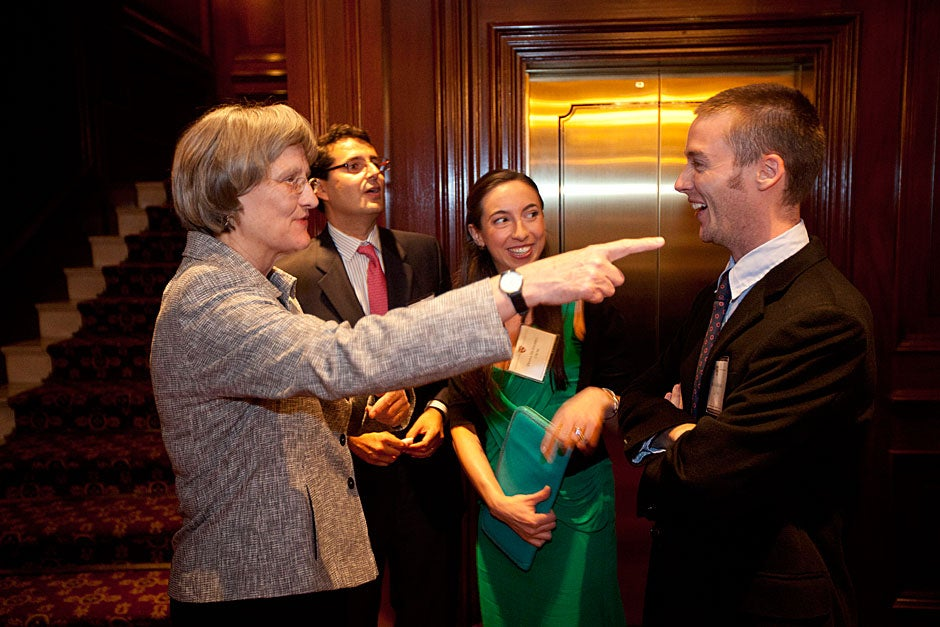 March 20, 2011. Harvard President Drew Faust (from left) talks with Rodrigo Ravilet, M.B.A. '03; Diana Huidobro, Harvard Extension School Certificate in Management '06; and Matias Rivera '08 during a reception before the Harvard Club of Chile dinner in the Ritz-Carlton, Santiago, Chile. Photo by Kris Snibbe/Harvard Staff Photographer