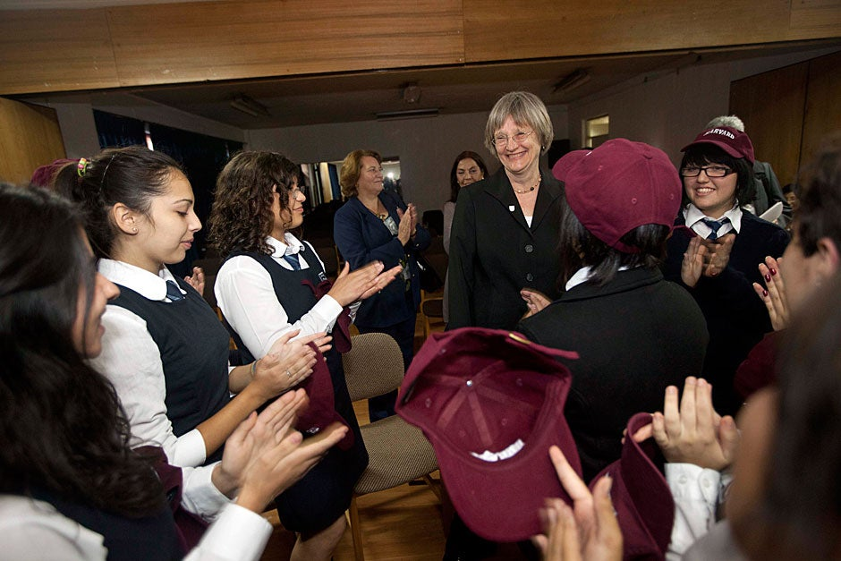 Harvard President Drew Faust visits Liceo Carmela Carvajal for a roundtable discussion with students Paloma Galvez (from left), Tamara Pérez, Shenoa Clermont, Javiera Castro, and Cecile Olguín (back shown) in Santiago, Chile. Photo by Kris Snibbe/Harvard Staff Photographer