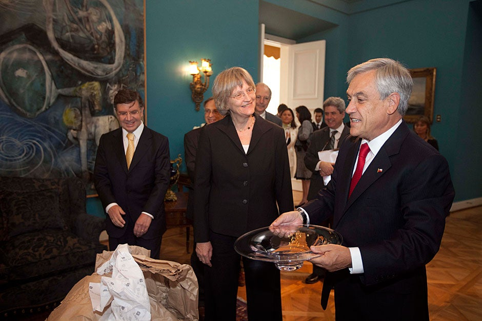 March 21, 2011. Harvard President Drew Faust (center) and Chilean President Sebastián Piñera (right) meet inside the La Moneda Palace in Santiago, Chile. On the left is Joaquín José Lavín Infante, minister of education of Chile. Photo by Kris Snibbe/Harvard Staff Photographer
