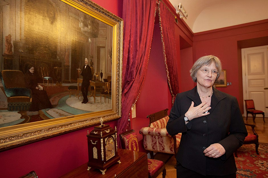 March 21, 2011. Harvard President Drew Faust views a painting of José Joaquín Pérez Mascayano (May 6, 1801-July 1, 1889), who served as the president of Chile between 1861 and 1871, and his wife, Tránsito Flores de la Cavareda, inside La Moneda Palace. Photo by Kris Snibbe/Harvard Staff Photographer