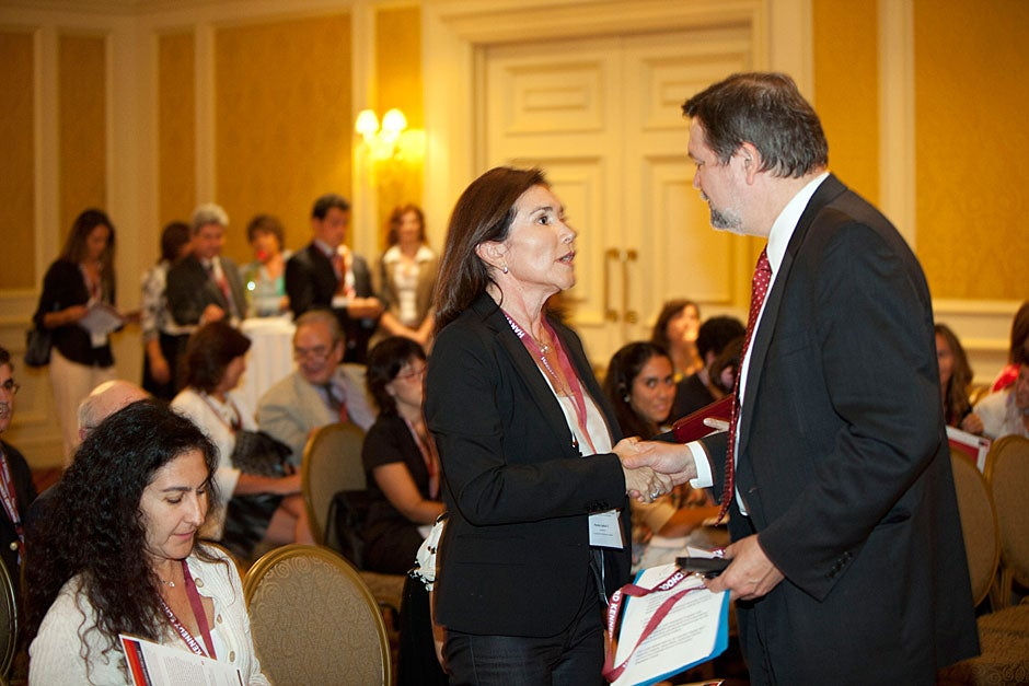 March 21, 2011. During the official launch of the Luksic Fellowship in Santiago, Chile, David Ellwood, dean of the Harvard Kennedy School and Scott Black Professor of Political Economy, thanks Paola Luksic. Photo by Kris Snibbe/Harvard Staff Photographer