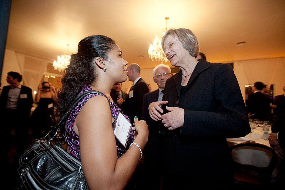 March 23, 2011. Jaissa Feliz '12 (left) and Harvard President Drew Faust talk after the Harvard Club of Brazil dinner at the Lemann residence in São Paulo, Brazil. Photo by Kris Snibbe/Harvard Staff Photographer