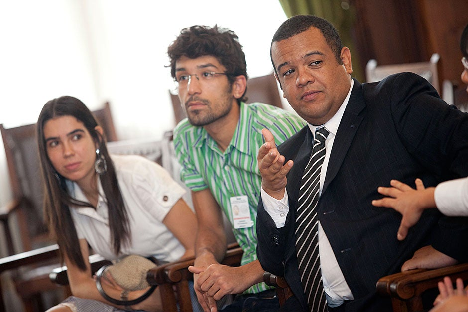 March 24, 2011. Universidade de São Paulo students Barbara Vital (from left), Leandro Tarosso, and Felipe Tadeu de Souza Lima discuss their experiences with Harvard President Drew Faust (not pictured). Photo