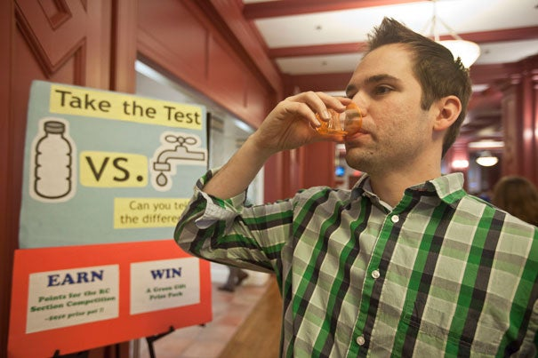 Harvard Business School student Eric Hepfer participates in the Green Living program's Tap vs. Bottled Water Tasting Challenge. Photo by Kris Snibbe/Harvard Staff Photographer