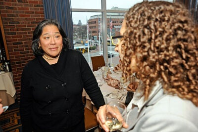 Tina Tchen '78, winner of the Harvard College Women's Professional Leadership Award, speaks with a friend before the ceremony at the Charles Hotel.