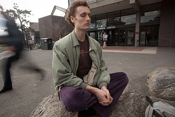Harvard Extension School student Jacob Hoover, A.L.B. '12, demonstrates a meditation exercise that he does prior to one of his dance performances.  Harvard researchers have found that mindfulness meditators more quickly adjust the brain wave that screens out distraction, which could explain their superior ability to rapidly remember and incorporate new facts.
