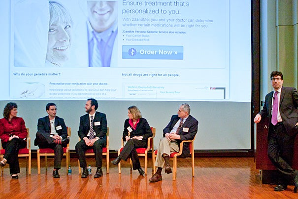 "Two panel discussions, organized by the School of Engineering and Applied Sciences, examined the ""promise and perils"" of creating digital repositories of genetic records. The second session, moderated by Jonathan Zittrain (far right, standing), examined the policy implications of an individual's right to access, control, and interpret his or her own genetic data. Panelists included Michelle Caggana (from left), Dan Vorhaus, John Schumann, Gaia Bernstein, and Art Beaudet."