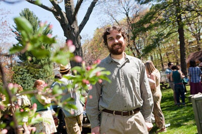 """""""I've learned a lot through my study of environmental ethics here at Harvard, but the garden has really been where the rubber meets the road, or more appropriately, the shovel meets the soil. Through a lived relationship with this community of plants, animals, and people, I've come to be me,"""" said Harvard Divinity School student Tim Severyn, seen here at the School's Community Garden."""