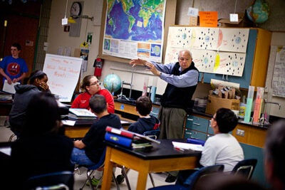Dick Post, retired businessman and ambassador in the Worldwide Telescope Ambassadors Program — the brainchild of astronomy Professor Alyssa Goodman — works with students at Clarke Middle School in Lexington on projects the kids made using an astronomy software by Microsoft.
