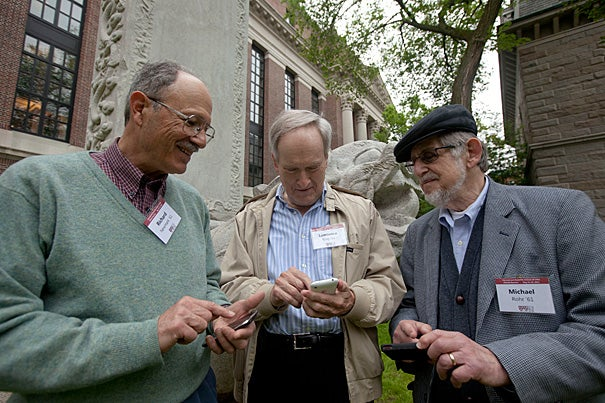 Alums Richard Nemmark (from left), Lawrence King, and Michael Rohr are on campus to celebrate their 50th reunion. The men are using the new Harvard/Radcliffe Reunion app, which allows reunion-goers to browse reunion events, add them to their calendars, see who else is attending, and view their own location on the campus map.