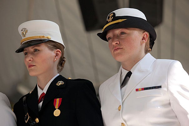 """Shawna Sinnott '10 (left) and Olivia Volkoff '10 are two of many Harvard alumni who are serving in the Army, Navy, or Marines. Volkoff, now an engineer at Naval Reactors headquarters in Washington, D.C., says """"It's hard to believe it's already been a year"""" since her graduation. Sinnott credits her special concentration """"Understanding Terrorism"""" for her success: """"Nowhere else would I have been able to create such an interdisciplinary concentration, learning from experts in every academic field."""""""