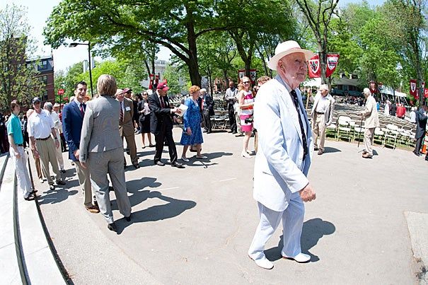 Nattily dressed John Francis Ambrose '41, a World War II infantry officer who was later in the silver trade, strolls at ease into the Tercentenary Theatre on May 26. He and 19 other classmates were back at Harvard for their 70th reunion.