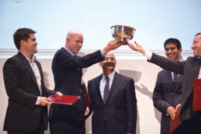 Harvard Business School Dean Nitin Nohria (center) presents Business Track awards for projects by HBS students Kimball Thomas (from left), Davis Smith, Romish Badani, and Haim Gottfried during the Harvard Business School's 15th annual Business Plan Contest in Burden Hall.