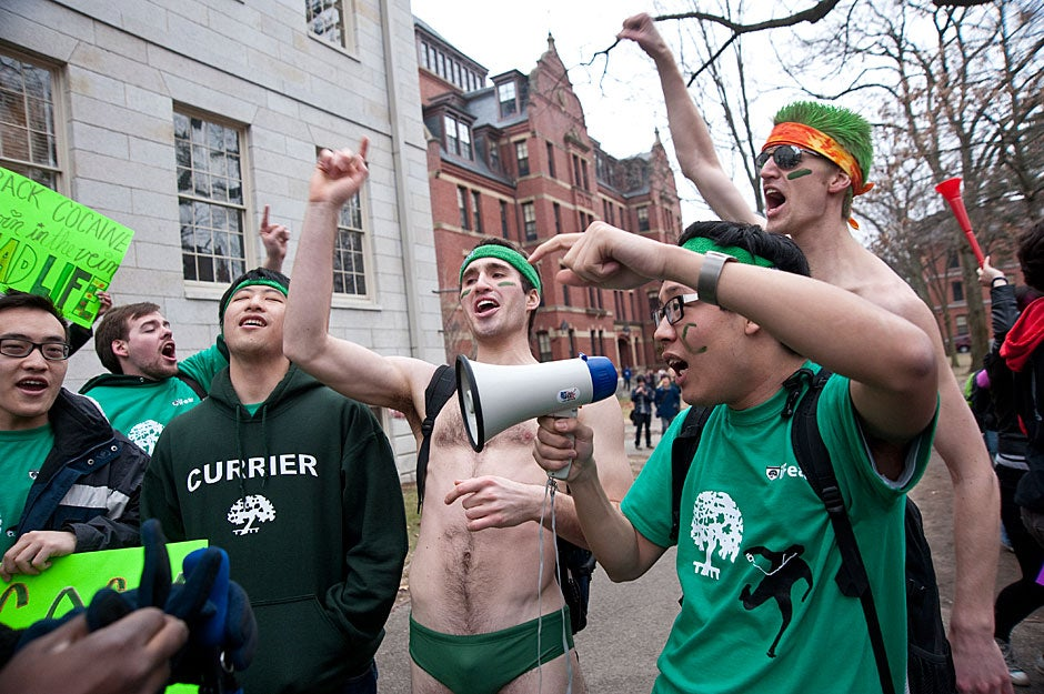 When the various Houses extend invitations for living assignments to freshmen, Mark Piana '11 (center, bare chest), and Kevin Chen '12 (right) whoop it up for Currier House. Jon Chase/Harvard Staff Photographer