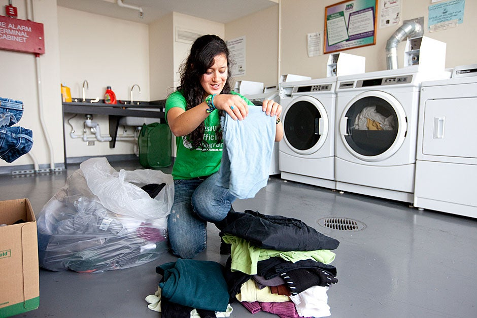 """Devon Newhouse '13, the """"Eco Rep"""" for Currier House, proves that trash can indeed be treasure: She hosts a swap for clothing — and whatever else — in the House's laundry room. Rose Lincoln/Harvard Staff Photographer"""