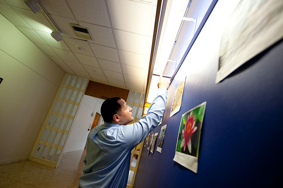 """As part of an effort to make the House """"greener,"""" Building Manager Manny Casillas replaced all incandescent lamps with compact fluorescent in all custodial, mechanical, and storage closets. Rose Lincoln/Harvard Staff Photographer"""