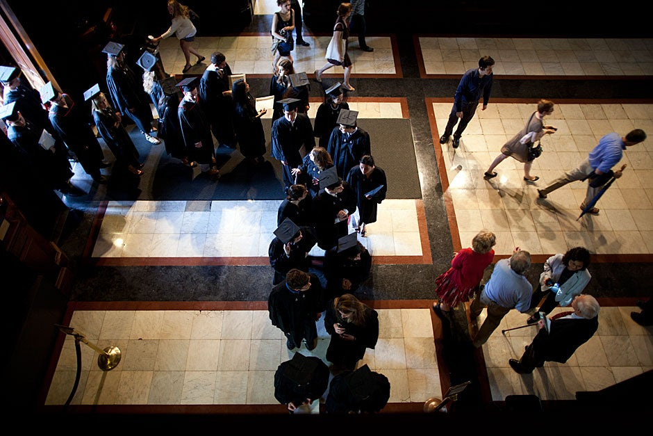 Members of the Class of 2011 enter the transept of Memorial Hall to attend the Phi Beta Kappa Literary Exercises in Sanders Theatre. Stephanie Mitchell/Harvard Staff Photographer