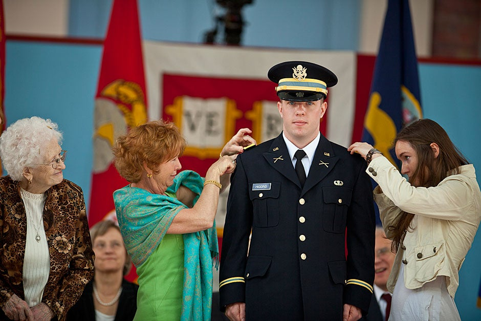 2nd Lt. Christopher Higgins has his bars placed on him by his mother and sister while his grandmother looks on during the ROTC Commissioning Ceremony. Justin Ide/Harvard Staff Photographer