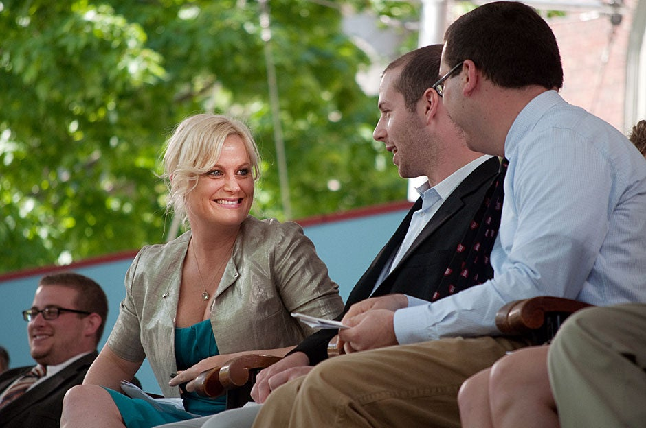 Amy Poehler (from left) chats with  Tobias Stein '11 and Eric Hysen '11 during the 2011 Class Day Exercises. Katherine C. Cohen/Harvard Staff Photographer