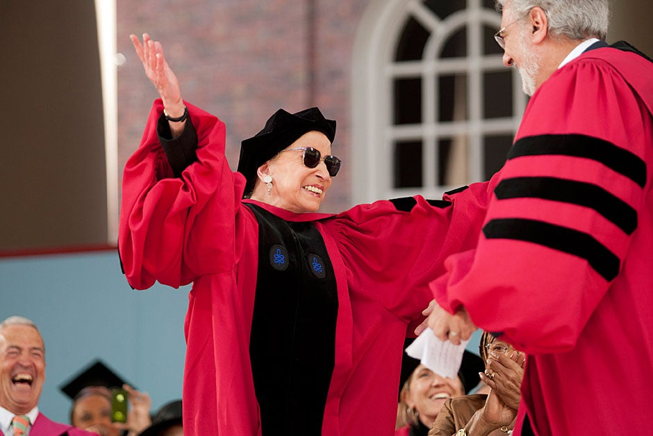 Honorary degree recipient Associate Justice of the Supreme Court Ruth Bader Ginsburg (left) hugs honorary degree recipient Plácido Domingo during Commencement. Brooks Canaday/Harvard University