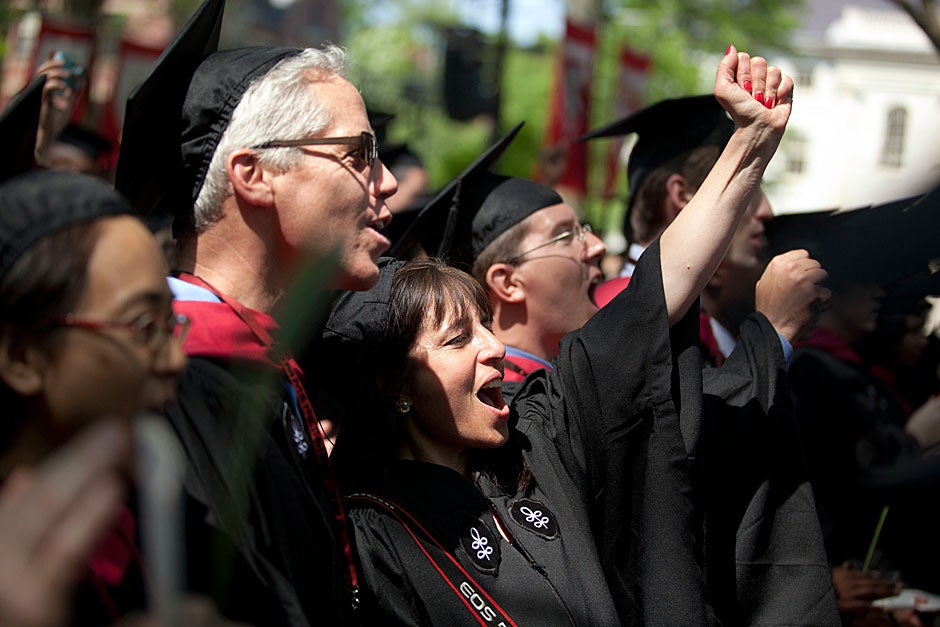 Extension School graduates Doug Gavel, A.L.M. (from left), Rose Lincoln, A.L.B. and Evan Whitney, A.L.M. celebrate together at Commencement. Kris Snibbe/Harvard Staff Photographer