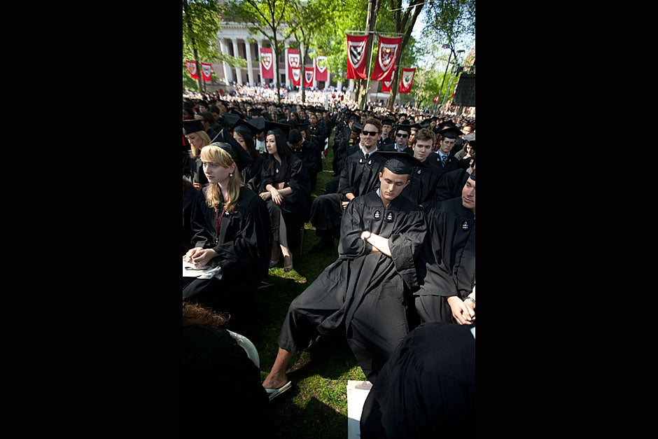 Paul Finnegan '11 rests momentarily during Commencement. Kris Snibbe/Harvard Staff Photographer