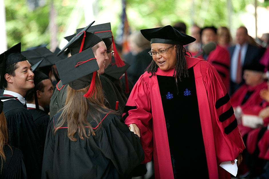 Harvard College Dean Evelynn M. Hammonds, Barbara Gutmann Rosenkrantz Professor of the History of Science and of African and African American Studies, congratulates students who graduated with high honors during Commencement. Kris Snibbe/Harvard Staff Photographer