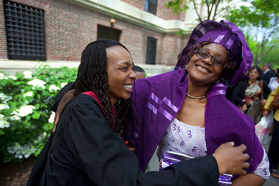 Dressed in traditional Nigerian attire, Khalidah Aderonke Bello HSPH '11 thanks her mother Toyosi Bello-Akinyele during Commencement. Kris Snibbe/Harvard Staff Photographer