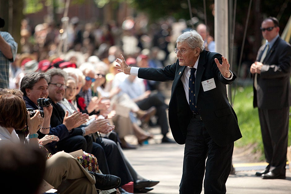The oldest Harvard graduate at Afternoon Exercises, Donald F. Brown '30, A.M. '35, Ph.D. '55, of Stow, Mass., dances during Afternoon Exercises. Both George Barner (not pictured) and Donald Brown are 102, though Brown is a month older. Kris Snibbe/Harvard Staff Photographer