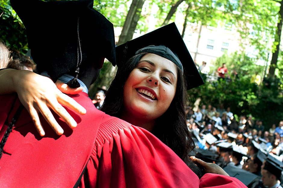Tiffany Fereydouni '11 is congratulated at Currier House after receiving her diploma. Katherine C. Cohen/Harvard Staff Photographer